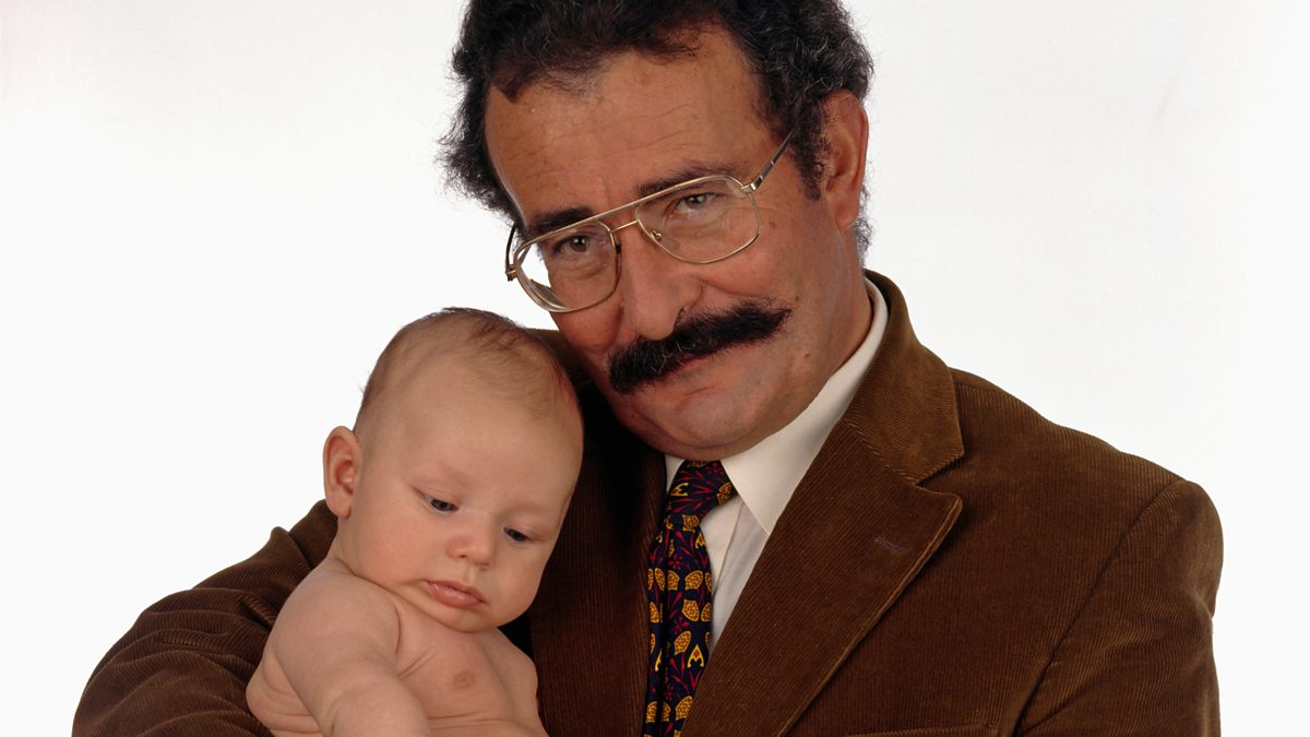 Lord Robert Winston holding a baby